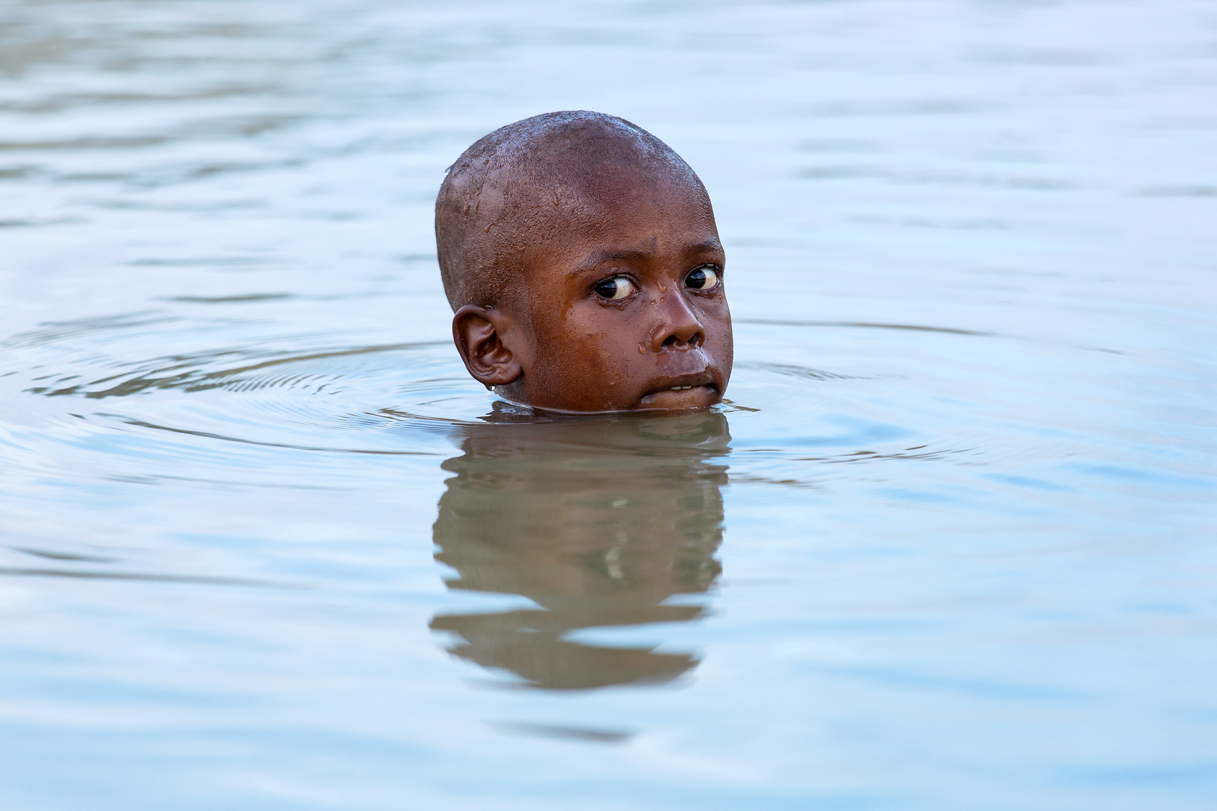 TRAVEL_HAITI_boy_water_bath_haitian_bitelip__editorial_4026_WB
